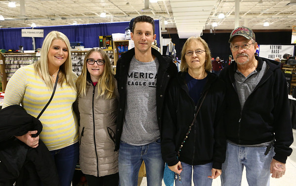 From left: Lisa Fisher, Autumn Bradfield, James Fisher, Becky Fisher, and Carl Fisher at the Wild Indiana Outdoor Expo on January 14, 2017.<br /> Kelly Lafferty Gerber | Kokomo Tribune