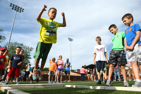 7-1-17<br /> Haynes Apperson Sports<br /> Derek Hicks Jr., 5, jumps during the long jump.<br /> Kelly Lafferty Gerber | Kokomo Tribune