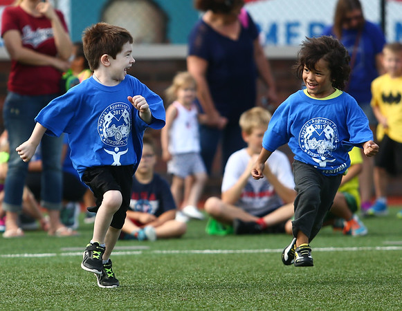 7-1-17<br /> Haynes Apperson Sports<br /> 4-year-olds Cooper Weasner, left, and J.T. Morales grin at each other as they begin the race.<br /> Kelly Lafferty Gerber | Kokomo Tribune