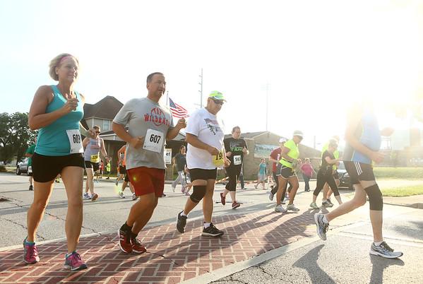 7-1-17<br /> Haynes Apperson Sports<br /> Runners and walkers begin the 5K.<br /> Kelly Lafferty Gerber | Kokomo Tribune
