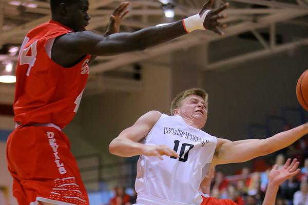 Sectional boys basketball between Western HS and West Lafayette on March 4, 2017. Western's Josh Beeler rebounding.<br /> Tim Bath | Kokomo Tribune