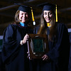 Kelly Karickhoff presents Yesenia Martinez with the Distinguished Alumni Award at Ivy Tech's graduation on Friday, May 12, 2017.<br /> Kelly Lafferty Gerber | Kokomo Tribune