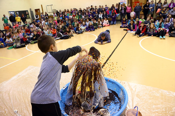 Howard Elementary Principal Rhonda Lanie gets splattered with ice cream sundae toppings from the top three students who raised the most money for Howard Elementary PTO. On Friday, November 3, 2017, they got to turn their principal, Rhonda Lanie, into an ice cream sundae.<br /> Kelly Lafferty Gerber | Kokomo Tribune