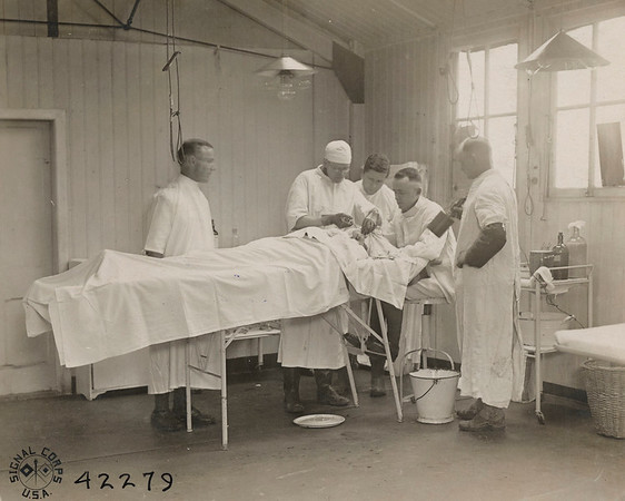 Capt. R. F. Risher operating on shrapnel wound in soldier's neck. Rouen, Seine Inferieure, France.<br /> National Archives