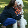 Debbie Nunnally gives Oliver, her goldendoodle, a kiss at Barktoberfest in Foster Park on Saturday, October 7, 2017.<br /> Kelly Lafferty Gerber | Kokomo Tribune
