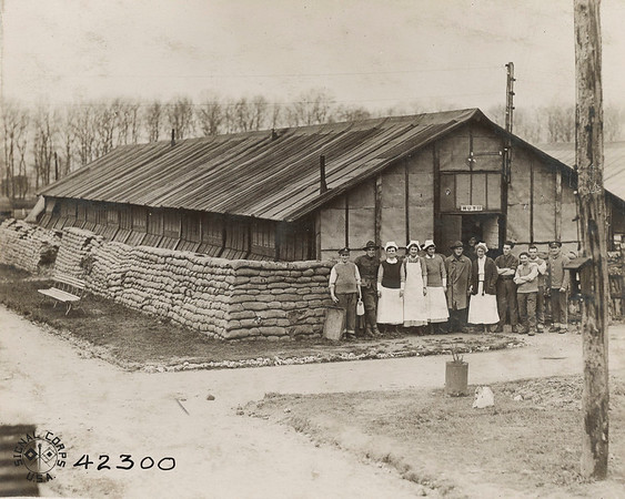Base Hospital No. 21, Hut No. 11, Note sand bags in front of building as protection to men in beds from air raids. Raids were frequent at this section. Amrican Rd Cross Nurses in front. Rouen, Seine, Inferieure, France.<br /> National Archives
