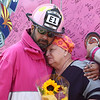 Teresa Galloway hugs retired firefighter Antonio Gonzales after the Pink Heals Tour visited her home on Sunday, September 10, 2017. The organization, which helps people, particularly women, who are battling cancer, made a stop in Howard County Sunday.<br /> Kelly Lafferty Gerber | Kokomo Tribune