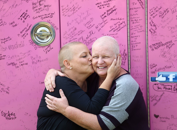 Lori Haalck gives Teresa Galloway a kiss as they stand in front of the pink fire truck on Sunday, September 10, 2017. The Pink Heals Tour stopped at both Galloway's and Haalck's homes on Sunday as part of the organization's national tour to help women battling cancer.<br /> Kelly Lafferty Gerber | Kokomo Tribune