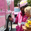Glenda Myers stands with retired firefighter Antonio Gonzales as they look for a spot on the pink fire truck for Myers to sign in memory of her aunt and grandmother who died from cancer. The Pink Heals Tour made a stop in Howard County on Sunday, September 10, 2017.<br /> Kelly Lafferty Gerber | Kokomo Tribune