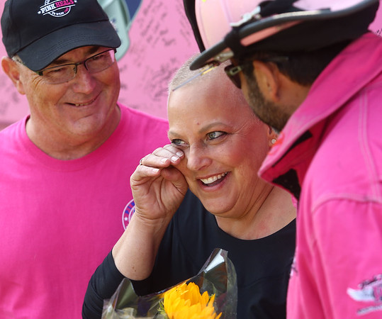 Lori Haalck wipes away a tear after the Pink Heals Tour stopped at her Greentown home on Sunday, September 10, 2017. The organization, which helps women battling cancer, stopped in Howard County on Sunday. Retired firefighter Ray Fitzgerald, left, is working on starting a local chapter of Pink Heals.<br /> Kelly Lafferty Gerber | Kokomo Tribune