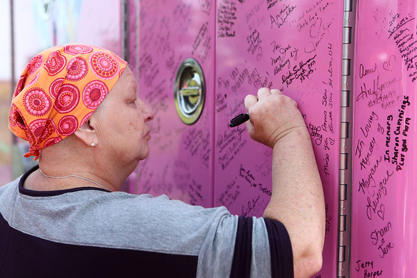 KPD Capt. Teresa Galloway signs the Pink Heals Tour fire truck on Sunday, September 10, 2017.<br /> Kelly Lafferty Gerber | Kokomo Tribune