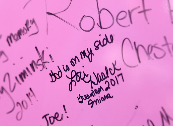 Lori Haalck signed the pink fire truck after the Pink Heals Tour stopped at her home in Greentown on Sunday, September 10, 2017. The Pink Heals Tour organization stopped in Howard County as part of its national tour to help women battling cancer. For every home they visit, people can sign the pink fire truck.<br /> Kelly Lafferty Gerber | Kokomo Tribune