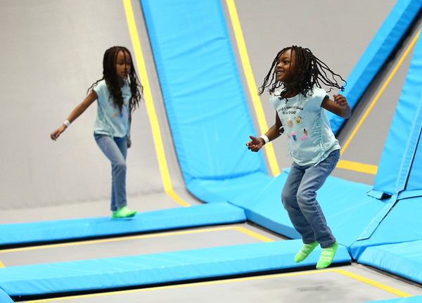 5-year-old Amour Holland, right, and her 6-year-old sister Daymaris Holland jump at the newly opened Gravity Trampoline Park in Markland Mall on Friday, April 20, 2018.<br /> Kelly Lafferty Gerber | Kokomo Tribune