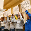 "Jazlyn Brown, right, and other students from The Crossing in Kokomo hold up a cardboard sign with a word that used to describe them, before ripping up the signs and holding up a new sign with a word describing how they've transformed as they share their ""cardboard stories"" during a celebration banquet on Thursday, April 26, 2018.<br /> Kelly Lafferty Gerber 