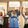 From left: August Smith, Adessa Denny, and Bryleigh Probst hold up cardboard with words revealing what they've transformed into after starting school at The Crossing in Kokomo. Students shared their stories during a celebration banquet on Thursday, April 26, 2018.<br /> Kelly Lafferty Gerber | Kokomo Tribune