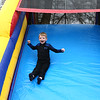 4-year-old Xavier Dowling smiles as he slides down the inflatable slide during Kokomo YMCA's Healthy Kids Day at Foster Park on Saturday, April 21, 2018.<br /> Kelly Lafferty Gerber | Kokomo Tribune