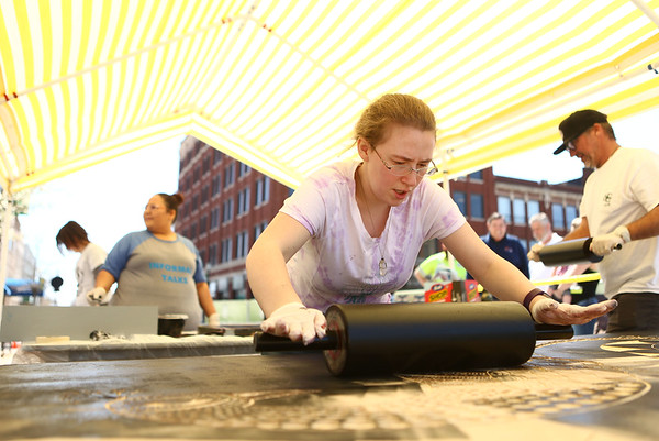 IUK student Larkin Stephen-Avery rolls ink onto a piece before it's put under the weight of a steamroller and transferred to paper for the IUK Relief Printmaking class on Thursday, April 26, 2018.<br /> Kelly Lafferty Gerber   Kokomo Tribune