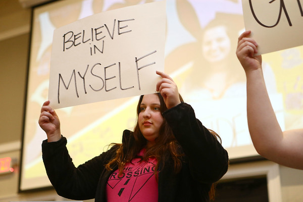 """Kylie Hawks shares her """"cardboard story"""" along with other students from The Crossing in Kokomo who first held up a sign with a word that used to describe them before tearing it up and holding up a new sign revealing how they've changed. Students from The Crossing shared their stories during a celebration banquet on Thursday, April 26, 2018.<br /> Kelly Lafferty Gerber 
