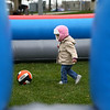 22-month-old Bella Spraker kicks around a ball in the inflatable GaGa Ball Pit at Foster Park during Kokomo YMCA's Healthy Kids Day on Saturday, April 21, 2018.<br /> Kelly Lafferty Gerber | Kokomo Tribune