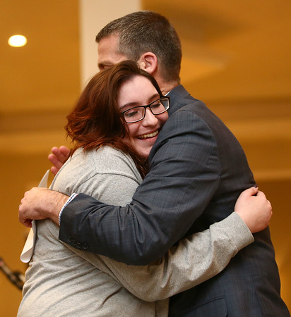 Haley Hodge gives a hug to board president Paul Wyman after Hodge shares her emotional journey of how she got to The Crossing in Kokomo during a celebration banquet on Thursday, April 26, 2018.<br /> Kelly Lafferty Gerber | Kokomo Tribune