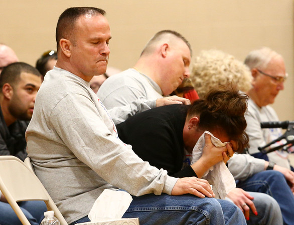 James and Lisa Keown listen as a song is played during the funeral for their 17-year-old son, Chad Keown, on April 17, 2018, at Tri-Central High School. <br /> Kelly Lafferty Gerber | Kokomo Tribune