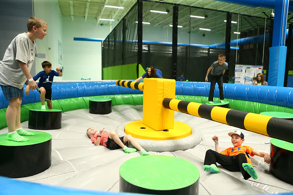 Kids try to keep their balance on The Wipeout at Gravity Trampoline Park in Markland Mall on its opening day, Friday, April 20, 2018.<br /> Kelly Lafferty Gerber | Kokomo Tribune