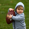 18-month-old Lillian Muller plays with a football at Foster Park during Kokomo YMCA's Healthy Kids Day on Saturday, April 21, 2018.<br /> Kelly Lafferty Gerber | Kokomo Tribune