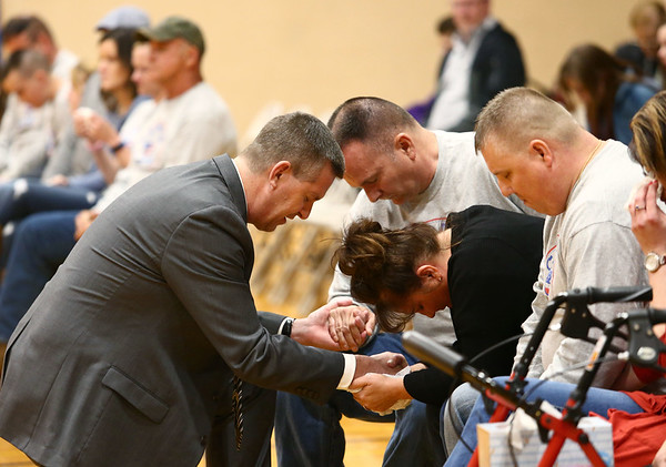 Pastor Kevin Carr prays with James and Lisa Keown before the start of the funeral for their 17-year-old son, Chad Keown, on April 17, 2018, at Tri-Central High School. Chad passed away on April 12.<br /> Kelly Lafferty Gerber | Kokomo Tribune