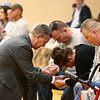 Pastor Kevin Carr prays with James and Lisa Keown before the start of the funeral for their 17-year-old son, Chad Keown, on April 17, 2018, at Tri-Central High School. Chad passed away on April 12.<br /> Kelly Lafferty Gerber   Kokomo Tribune