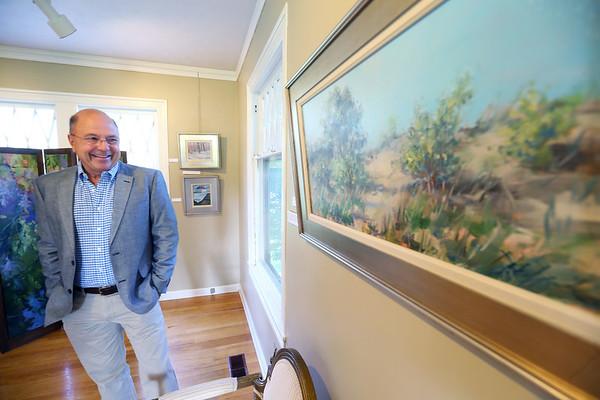 Artist Douglas David with some of his work that is on display at the Kokomo Art Center on Ricketts Street on Aug. 13, 2018.<br /> Tim Bath | Kokomo Tribune