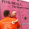 4-year-old Audrey Corn smiles as she and her dad Denny Broens take a look at the names on the pink firetruck parked outside Corn's home on Friday, August 24, 2018. The Pink Heals Tour made a stop to see Audrey, who was diagnosed with leukemia on March 24 earlier this year.<br /> Kelly Lafferty Gerber | Kokomo Tribune
