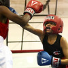 Carver Community Center's Elijah Merriweather takes a swing at Sims Boxing's Ricky Driver in the junior division of the Carver Center Boxing Show on Saturday, August 25, 2018. Merriweather won the bout.<br /> Kelly Lafferty Gerber | Kokomo Tribune