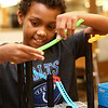 11-year-old Zavier Bell follows a guide as he builds a rollercoaster track during Digital Divers at the Kokomo-Howard County Public Library on August 21, 2018.<br /> Kelly Lafferty Gerber | Kokomo Tribune