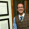 Financial advisor Jake Brown on August 3, 2018, with framed documents from the financial advisory business his great grandfather started in the 1920's. Brown was recently named a top broker by Forbes magazine.<br /> Kelly Lafferty Gerber | Kokomo Tribune