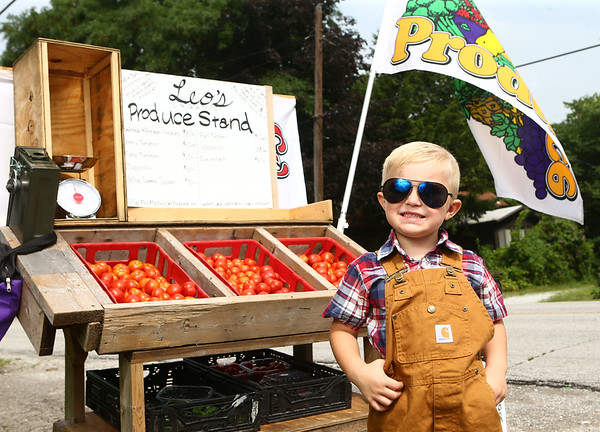 """4-year-old Leo Massey with his stand, """"Leo's Produce Stand,"""" in West Middleton on Wednesday, August 1, 2018. The money Leor eceives from his produce stand is going to his college fund.<br /> Kelly Lafferty Gerber 