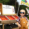 "4-year-old Leo Massey with his stand, ""Leo's Produce Stand,"" in West Middleton on Wednesday, August 1, 2018. The money Leor eceives from his produce stand is going to his college fund.<br /> Kelly Lafferty Gerber 