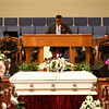 """Pastor Jack Woodard, standing at the pulpit between balloons reading """"Princess"""" officiates the funeral of 10-year-old Renay Jenkins on Saturday, August 18, 2018.<br /> Kelly Lafferty Gerber 