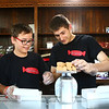 Sophomore Jonah Hughes, left, and senior Joshua Tracy work together to weight peanut butter fudge at Kokomo Confectioners' Company, located at 207 East Superior Street, on its opening day, Tuesday, August 28, 2018.<br /> Kelly Lafferty Gerber | Kokomo Tribune