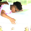 23-year-old Antrinique Simmons kisses the casket of her 10-year-old sister Renay Jenkins before the casket is lowered into the ground at Albright Cemetery on Saturday, August 18, 2018. Jenkins was killed in a hit-and-run accident on August 9.<br /> Kelly Lafferty Gerber | Kokomo Tribune