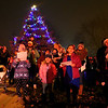 Kids sing Christmas carols as they stand in front of the Russiaville Christmas tree and wait for Santa to arrive during Winter Fest on Friday, November 30, 2018.<br /> Kelly Lafferty Gerber | Kokomo Tribune