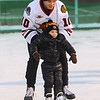 The Indy Fuel hockey player Kevin Dufour takes 3-year-old Gus Casler around the ice as the team visits Kokomo's Frozen Sandlot on Tuesday, December 18, 2018.<br /> Kelly Lafferty Gerber | Kokomo Tribune