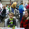 Preston Dyer, 2, sticks an ornament decoration on his forehead after sticking one on the forehead of his mom, Lyndsey Dyer, during the Russiaville Winter Fest on Friday, November 30, 2018.<br /> Kelly Lafferty Gerber | Kokomo Tribune