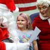 Gracelynn Cook, 4, tells Santa and Mrs. Claus what she wants for Christmas during the Russiaville Winter Fest on Friday, November 30, 2018.<br /> Kelly Lafferty Gerber | Kokomo Tribune