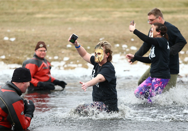 A Star Wars-themed group records their splash into the pond at Crossroads Community Church during the Polar Plunge on Saturday, February 3, 2018.<br /> Kelly Lafferty Gerber | Kokomo Tribune