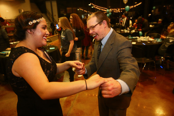 Lucia Perez and Lucas Eldridge cut a rug on the dance floor during Night to Shine, a  prom night experience for people with special needs at Oakbrook Church on Friday, February 9, 2018.<br /> Kelly Lafferty Gerber | Kokomo Tribune