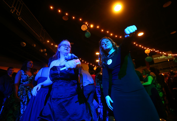 Claire Coaner, left, and Makenzie Quinn do the whip and nae nae as the song plays during Night to Shine, a  prom night experience for people with special needs at Oakbrook Church on Friday, February 9, 2018.<br /> Kelly Lafferty Gerber | Kokomo Tribune