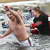 A group from Taylor Community Schools braves the frigid waters during the Polar Plunge at Crossroads Community Church on Saturday, February 3, 2018.<br /> Kelly Lafferty Gerber | Kokomo Tribune