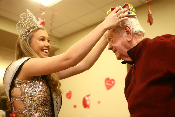 Ally Wimmer, Miss Howard County 2017, crowns the king of the Sweethearts Ball, Gordon Brown, at Wellbrooke of Kokomo on February 14, 2018.<br /> Kelly Lafferty Gerber | Kokomo Tribune