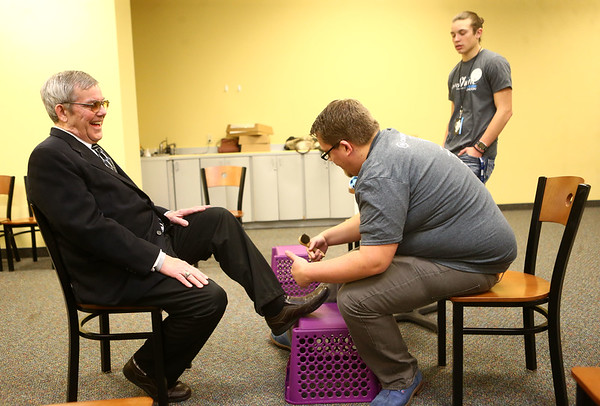 Samuel Creech gets his shoes shined by Collin Johnson during Night to Shine, a prom night experience for people with special needs at Oakbrook Church on Friday, February 9, 2018.<br /> Kelly Lafferty Gerber   Kokomo Tribune