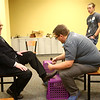 Samuel Creech gets his shoes shined by Collin Johnson during Night to Shine, a prom night experience for people with special needs at Oakbrook Church on Friday, February 9, 2018.<br /> Kelly Lafferty Gerber | Kokomo Tribune